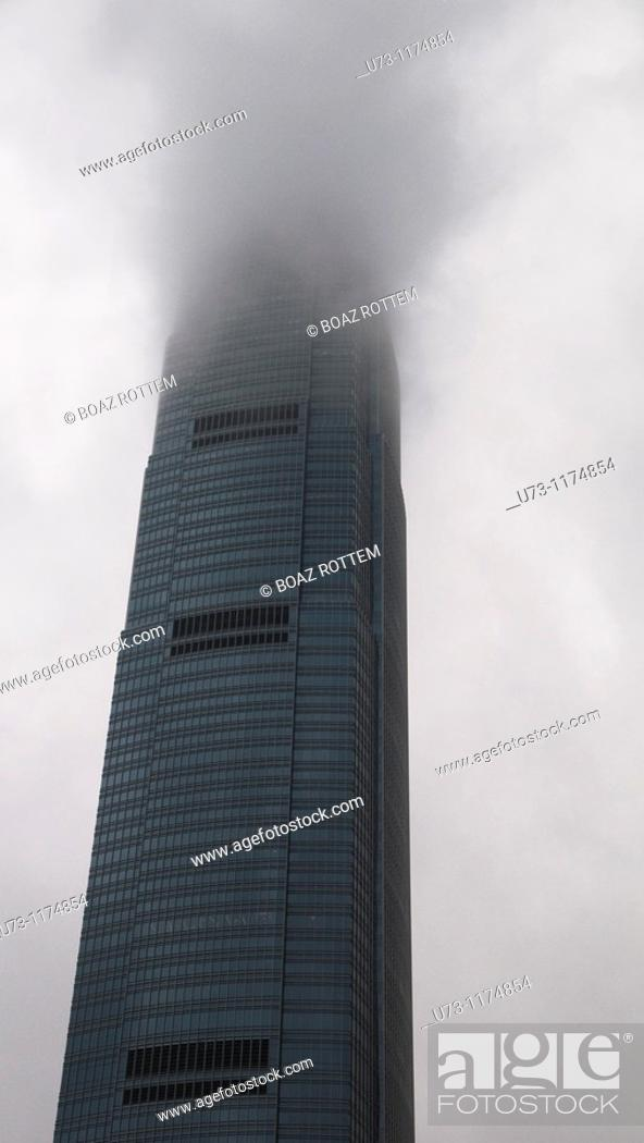 Stock Photo: IFC tower in Hong Kong covered with clouds.