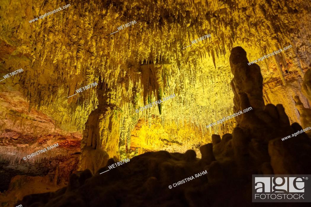 Stock Photo: Cave interior with stalactites and stalagmites lit in colors near Porto Cristo, Mallorca, Spain.
