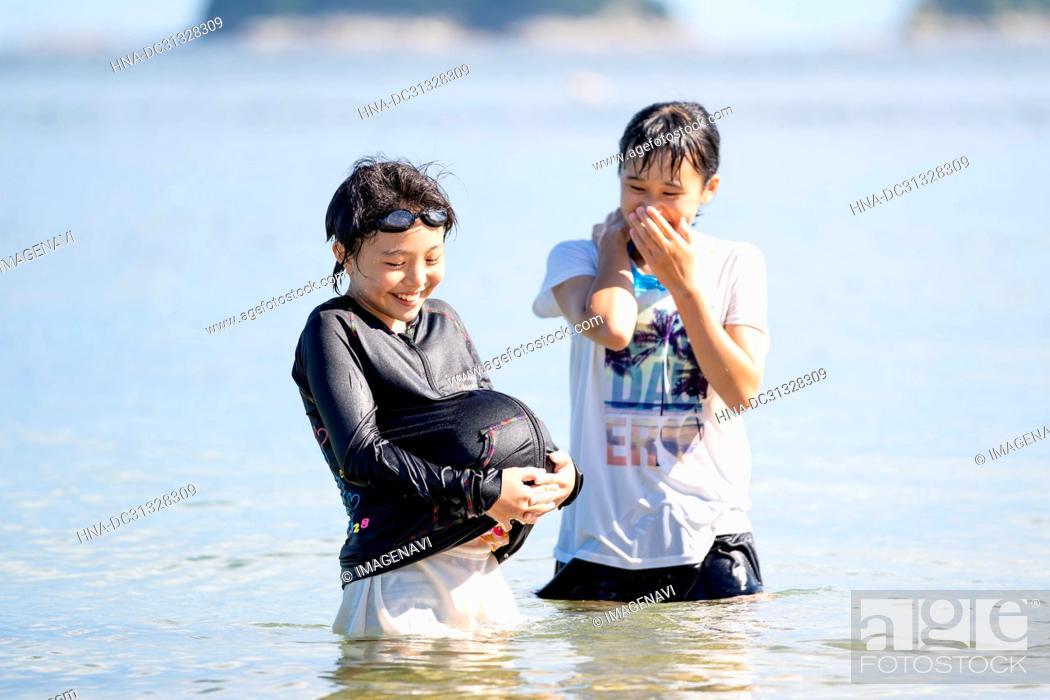 Stock Photo: Girls Swimming in Beach.
