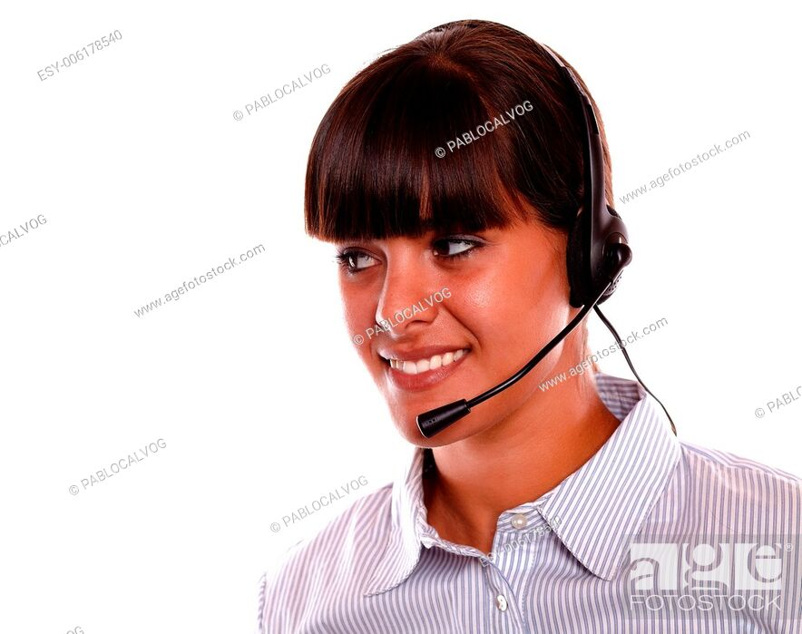 Stock Photo: Portrait of a smiling young woman using earphone looking to her right on isolated background - copyspace.