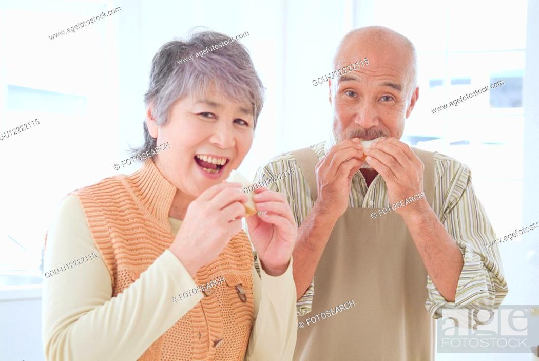 Stock Photo: Senior Husband And Wife Who Eat Sandwiches.