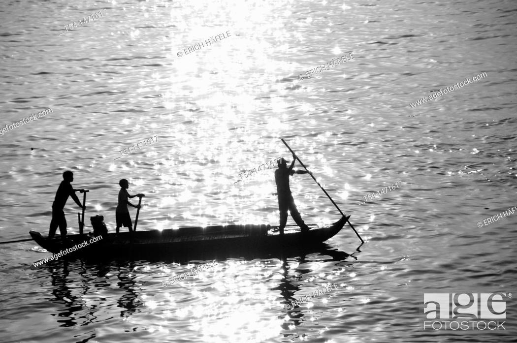 Stock Photo: Fishingboat at the Mekong River.