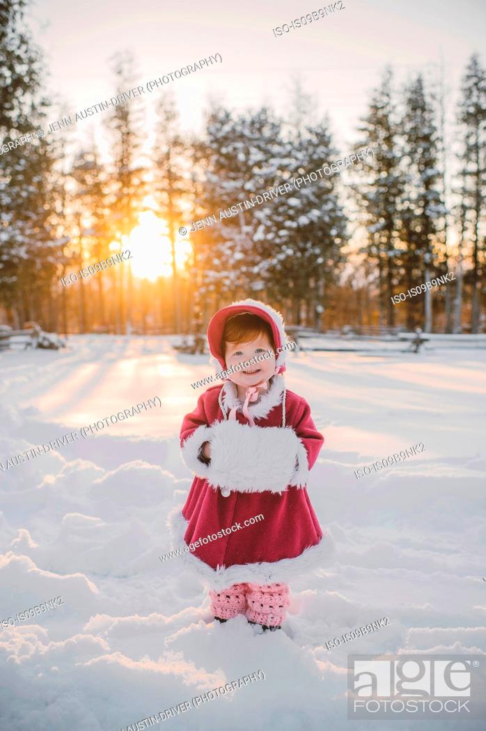 Stock Photo: Portrait of young girl standing in snow.