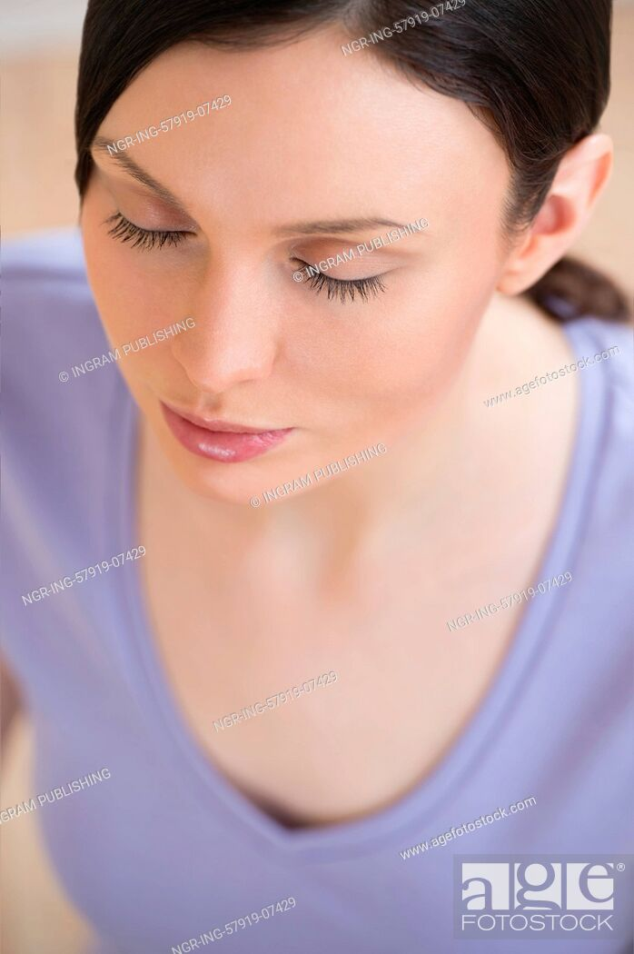 Stock Photo: Portrait of beautiful young woman doing yoga exercise - Meditating.