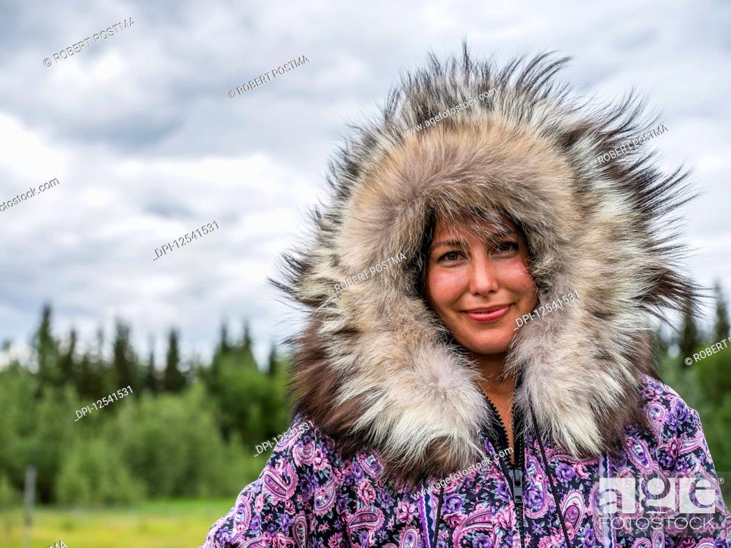 Photo de stock: First nation woman dressed in handmade traditional coat; Mayo, Yukon, Canada.