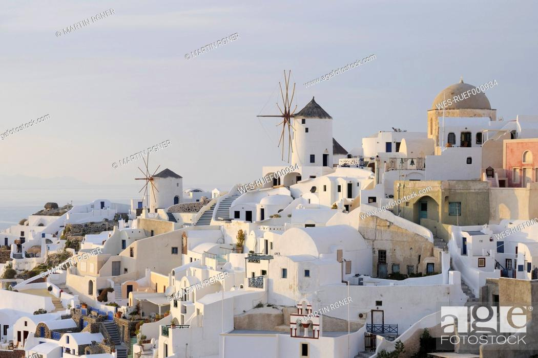 Stock Photo: Greece, Windmill with cobbled path and green gate in traditionally Greek village Oia at Santorini.