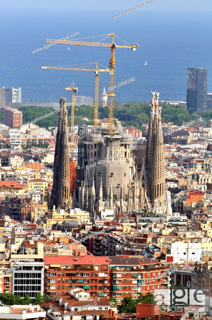 Stock Photo: Overview of Barcelona from Turó del Carmel with the Temple of the Sagrada Familia under construction. Catalonia. Spain.