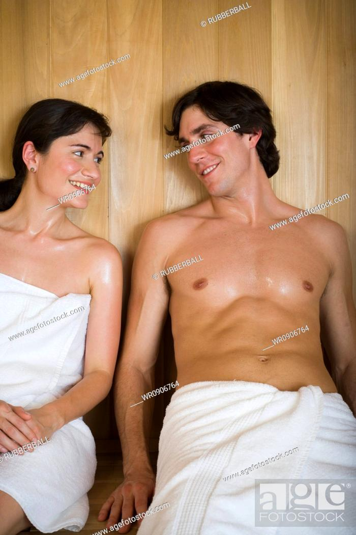 Stock Photo: Close-up of a young couple sitting in a sauna and looking at each other.