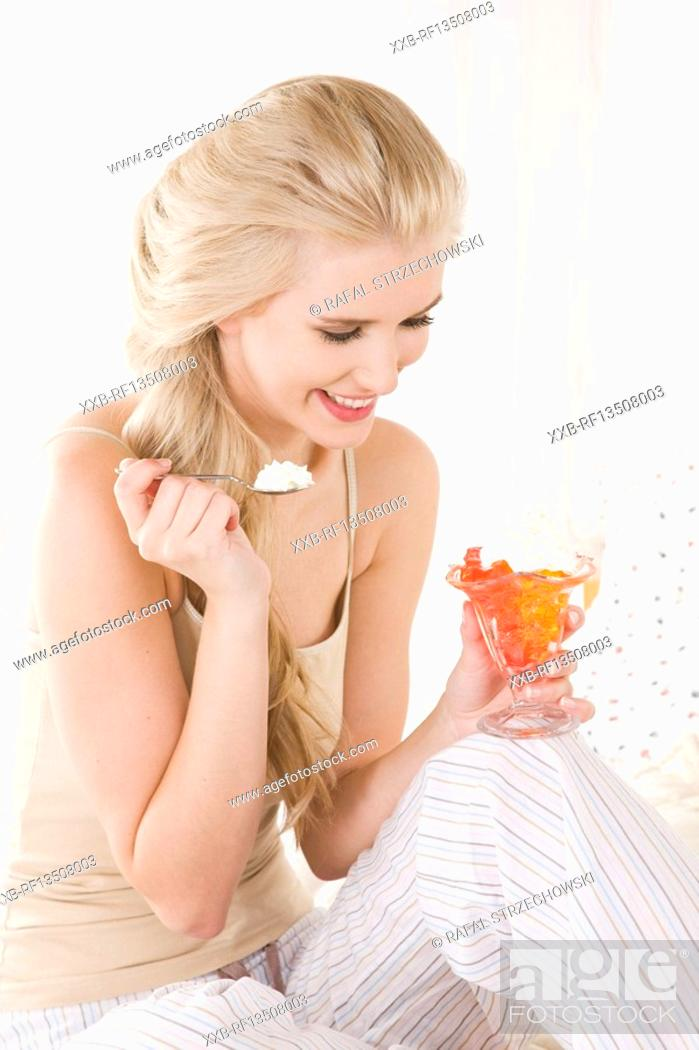 Stock Photo: Woman eating jelly with cream.