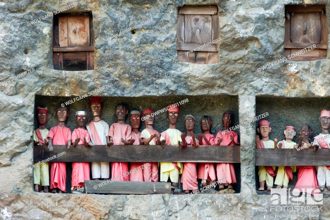 Stock Photo: Indonesia, Sulawesi Selatan, Tana Toraja, Torajaland, Human wooden figures next to rock tombs, dew are carved wooden figures, rock tombs, death cult.
