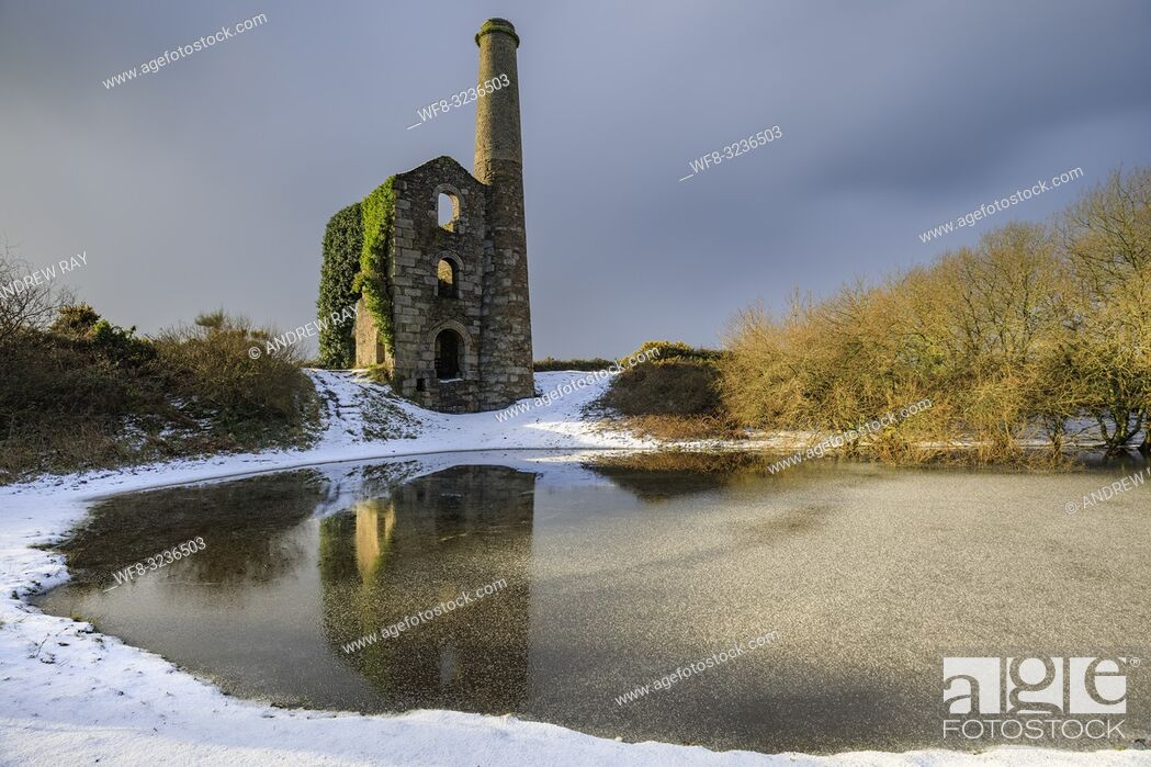Stock Photo: The Cornish engine house and pool on United Downs in Cornwall bathed in early morning light. The image was captured using a long exposure after a snowfall in.