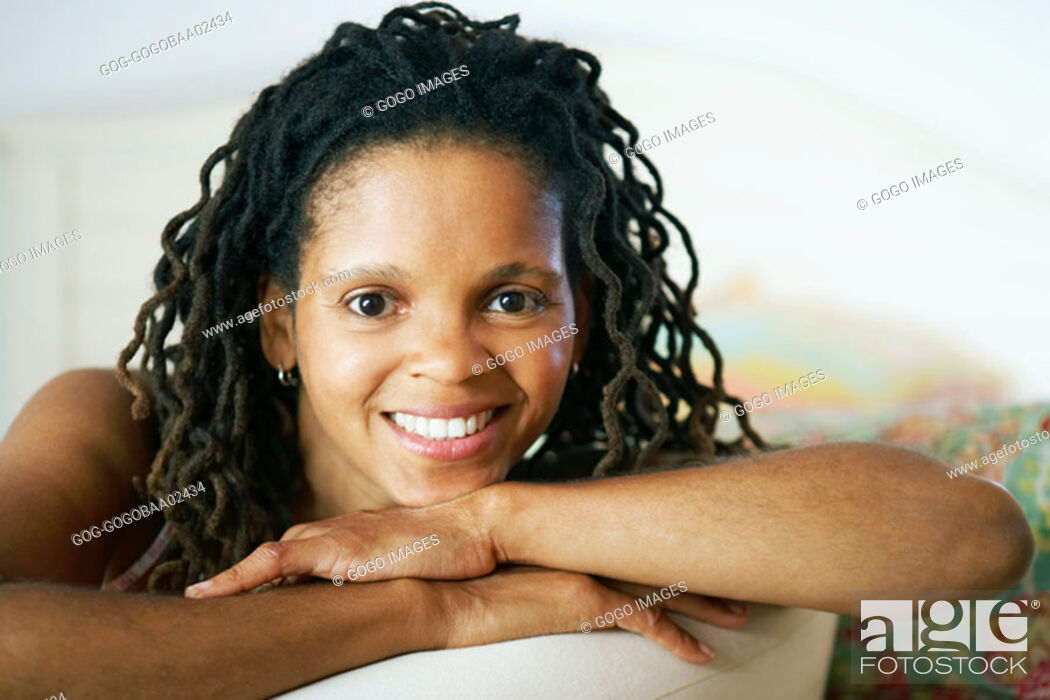 Stock Photo: Young African woman smiling.