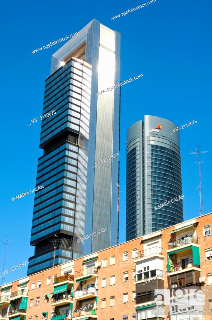 Stock Photo: Two of the Four Towers contrasting with tenements. Madrid, Spain.