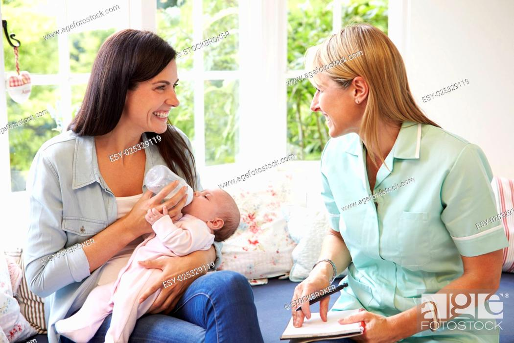 Stock Photo: Mother With Baby Meeting With Health Visitor At Home.