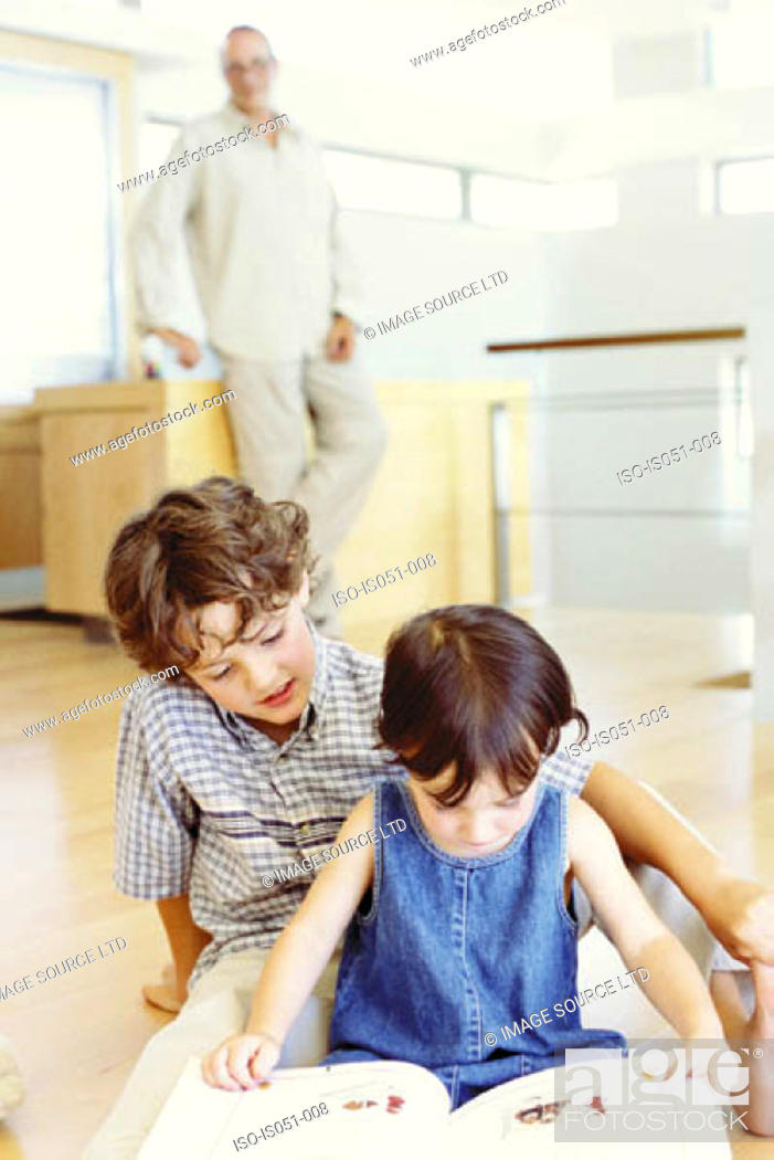Stock Photo: Brother and sister reading.