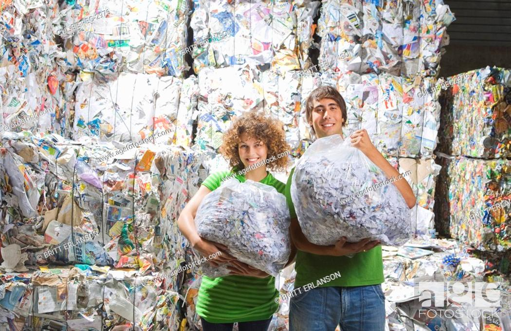 Stock Photo: Man and woman at a recycling plant.