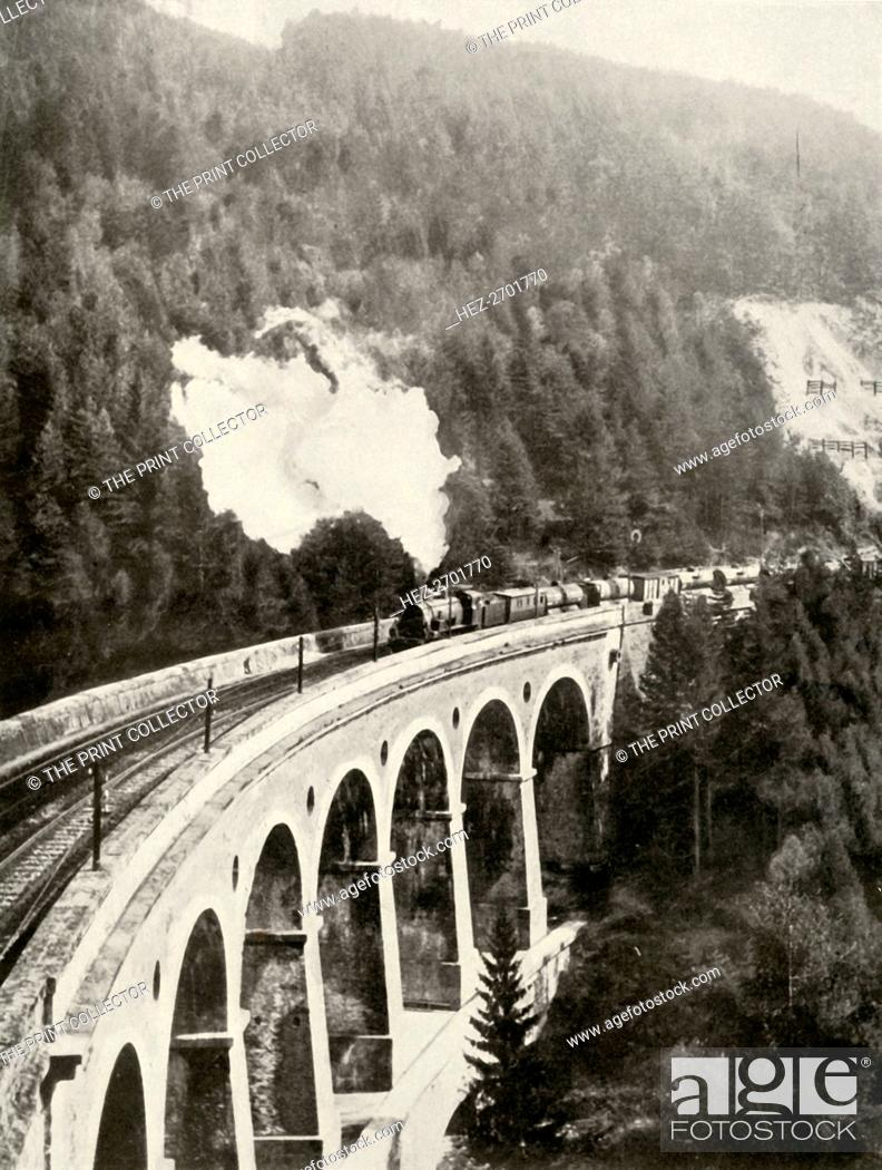 Stock Photo: 'In the Semmering Valley, Austria. A good train crossing the curved Gamperl Viaduct', 1935-36. Creator: Unknown.