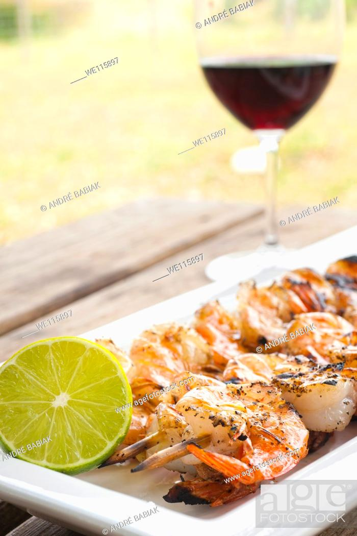 Stock Photo: Grilled shrimp skewers with fresh lemon.