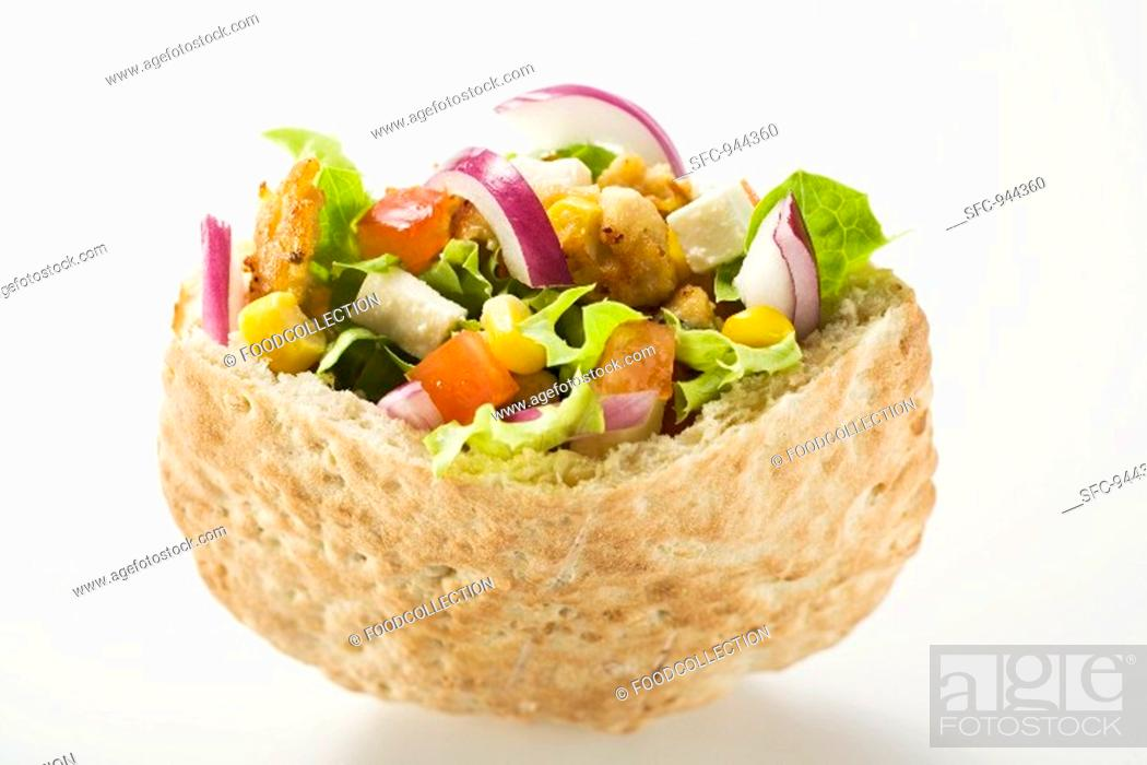 Stock Photo: Pita bread filled with vegetables and roast turkey breast.