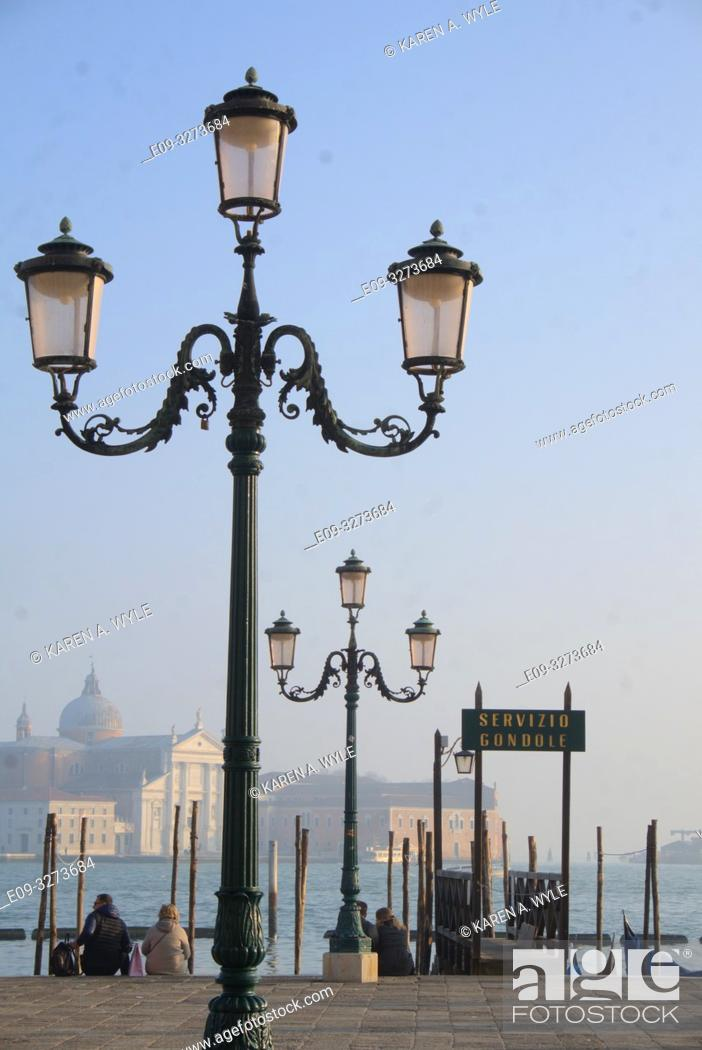 Stock Photo: lampposts near gondola dock along Riva degli Schiavoni on Grand Canal, Venice, Italy.