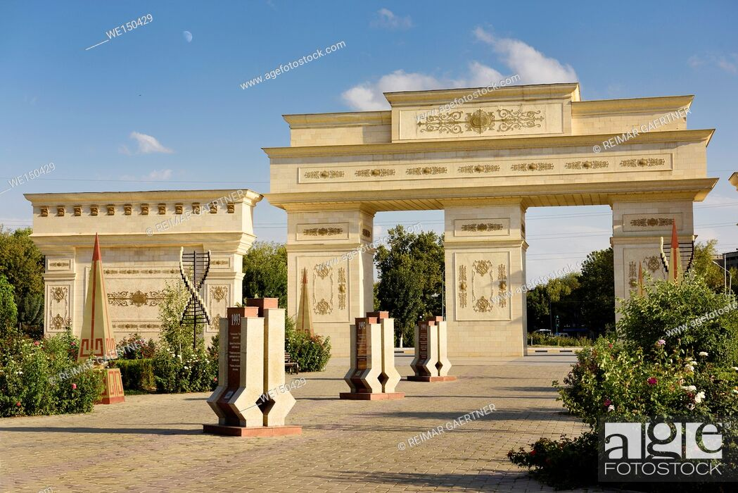 Stock Photo: Ornate gates to Independence Park Shymkent Kazakhstan with granite steles with 20 years history 1991 to 2011.