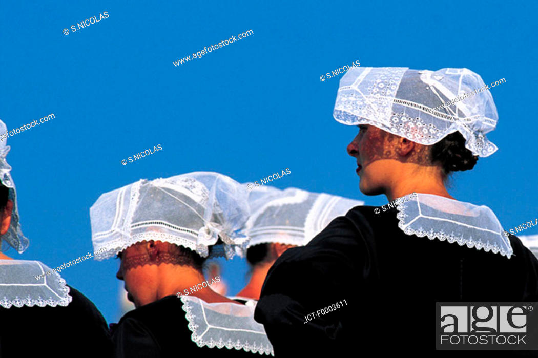 Stock Photo: France, Brittany, People wearing traditional costumes.