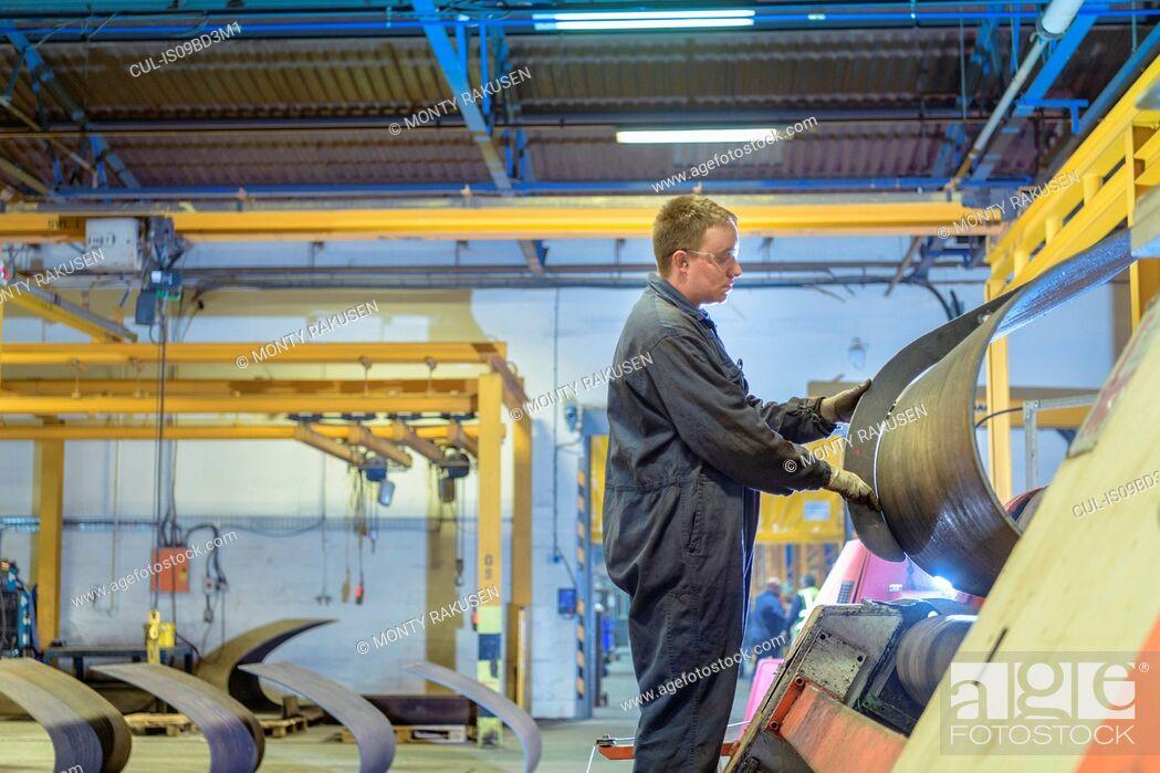 Stock Photo: Engineer operating steel bending machine in engineering factory.
