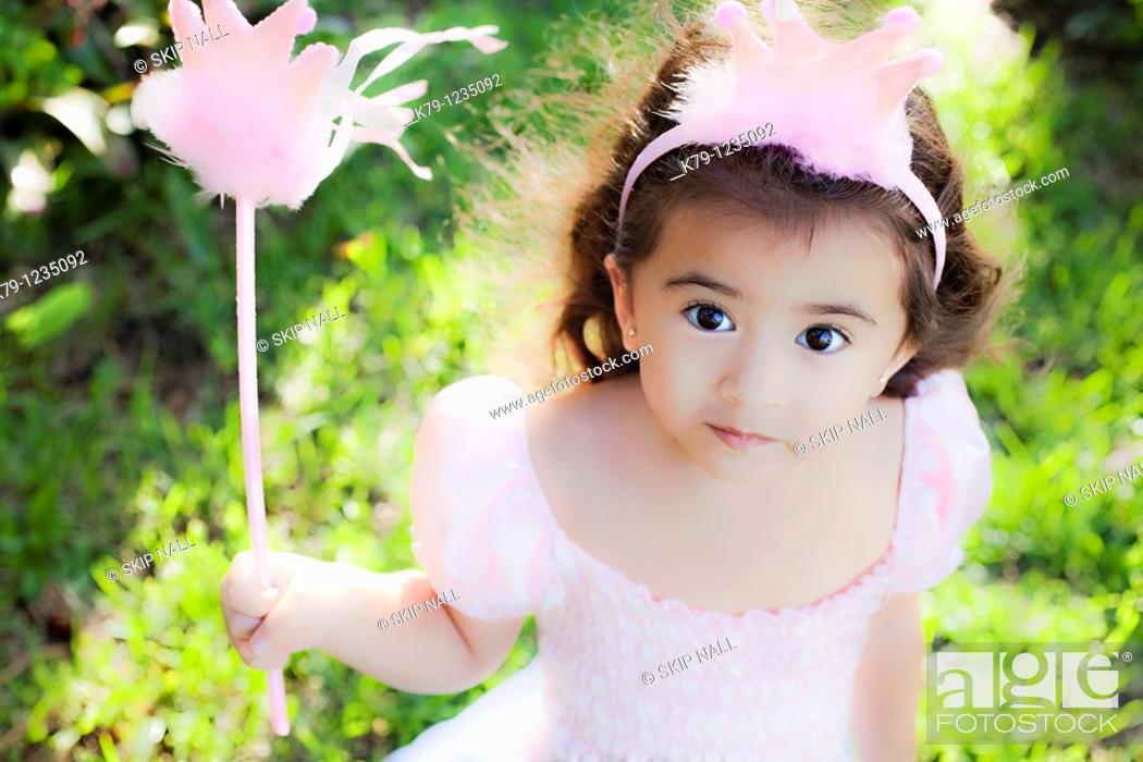 Stock Photo: Little girl playing dress up as a princess.