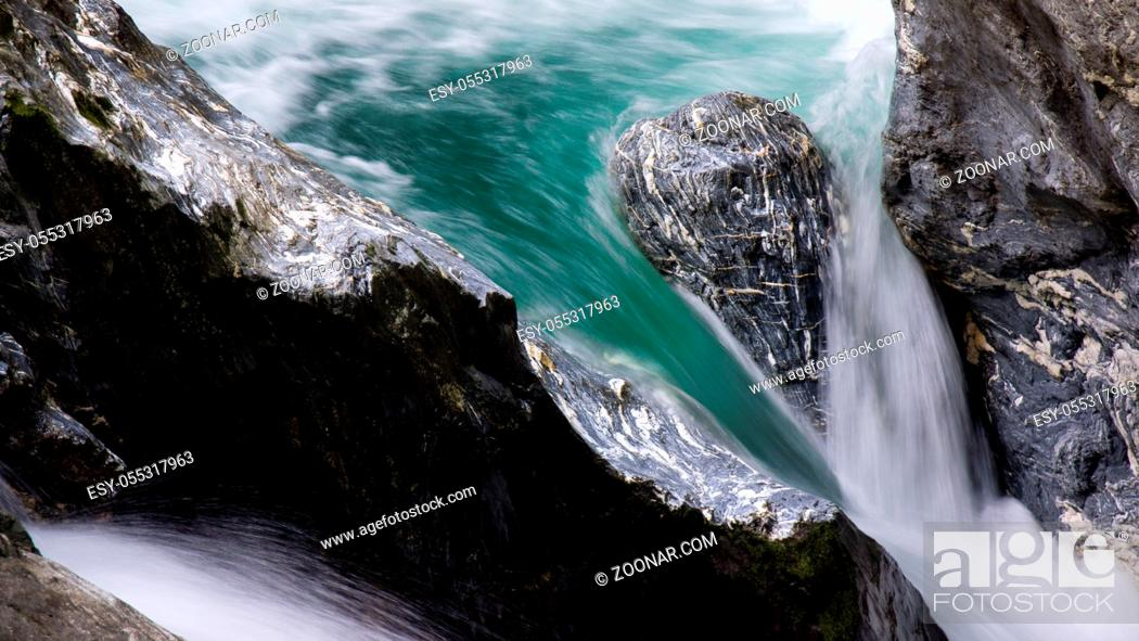 Photo de stock: hiking in austria clear blue waterfall close up on mountain canyon.