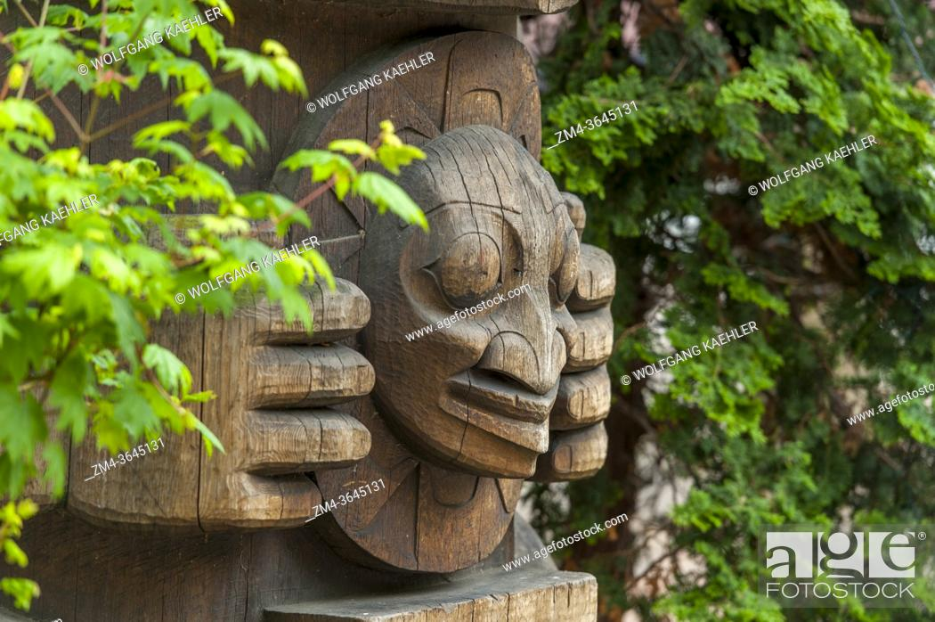 Stock Photo: The detail of a totem pole (1980s) by Duane Pasco in Occidental Park in Seattle in Washington State, USA.