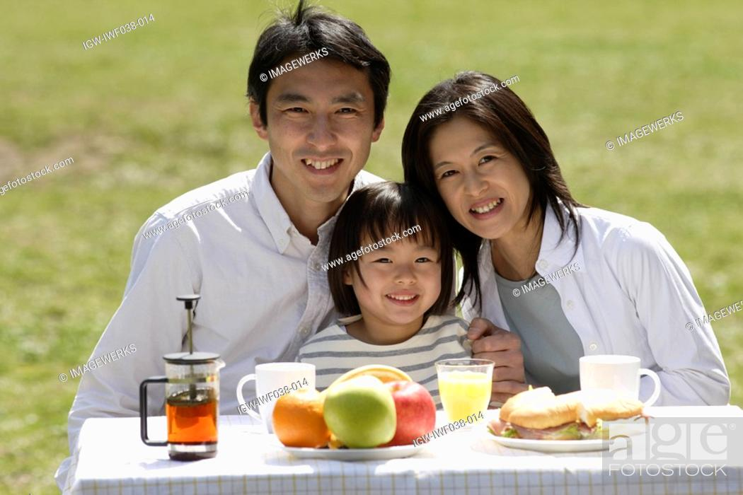 Stock Photo: Portrait of a family having breakfast.