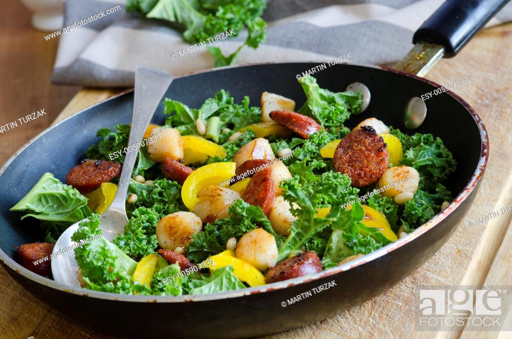 Stock Photo: Spanish sausage, scallops, kale and yellow bell peppers in a pan.