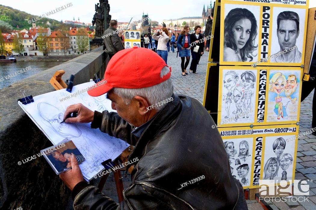 Stock Photo: Cartoonist Drawing Picture of photo  In charles bridge Prague  Czech Republic.