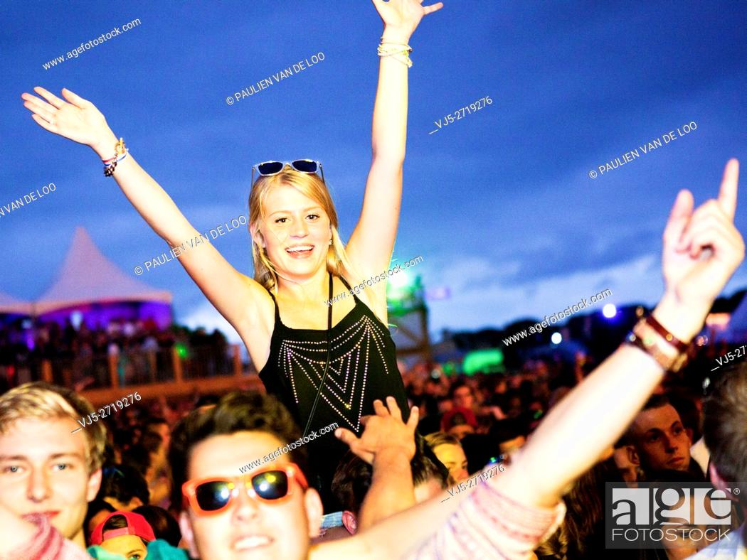 Stock Photo: Beek en Donk, Netherlands, Cheering young people at an event while listening to good music.