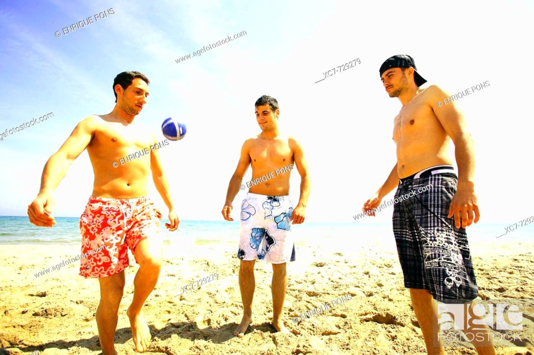 Stock Photo: Friends playing on beach.