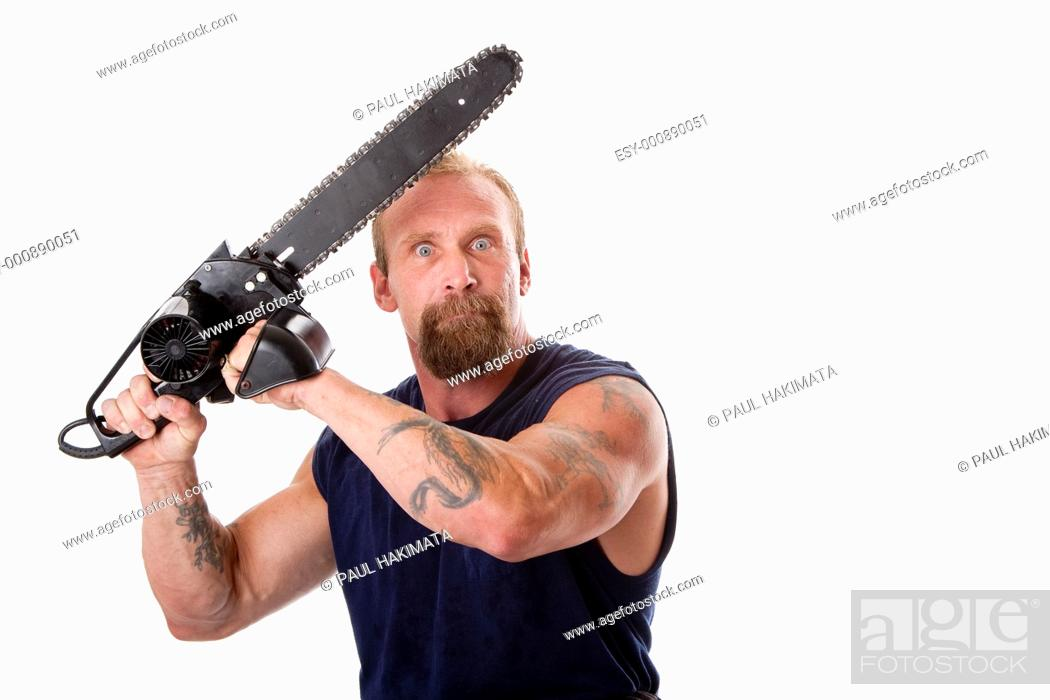 Stock Photo: Crazy Caucasian man with tattoos and chainsaw above his head with strong expression in eyes, isolated.