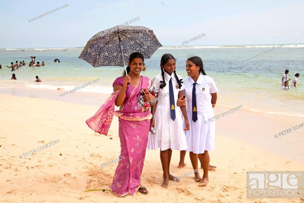 Stock Photo: female teacher and schoolgirls at the beach in Polhena, Matara, LKA, Sri Lanka.