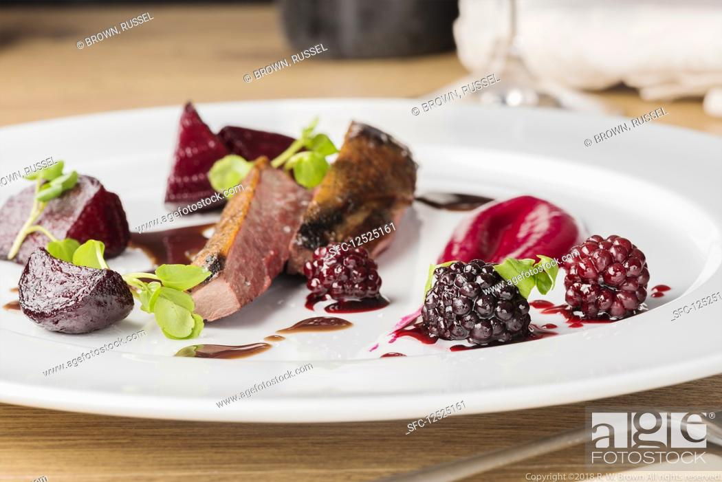 Stock Photo: Wild duck with blackberries and beetroot.
