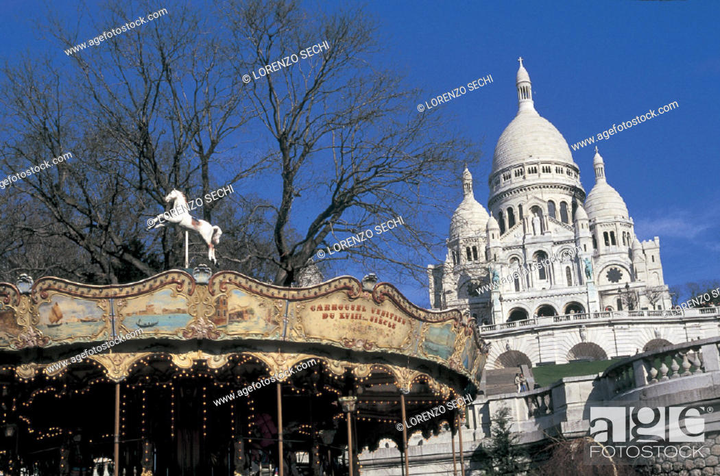 Stock Photo: france, paris, montmartre, basilica of sacre-coeur and the merry-go-round.
