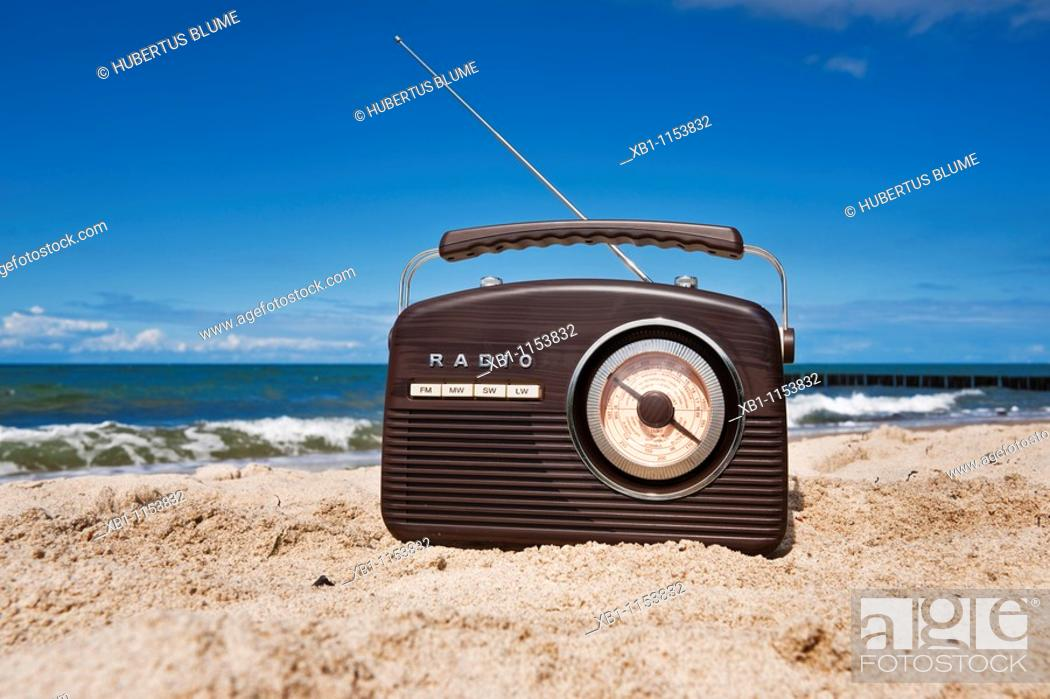 Stock Photo: a radio stands on a sandy beach.