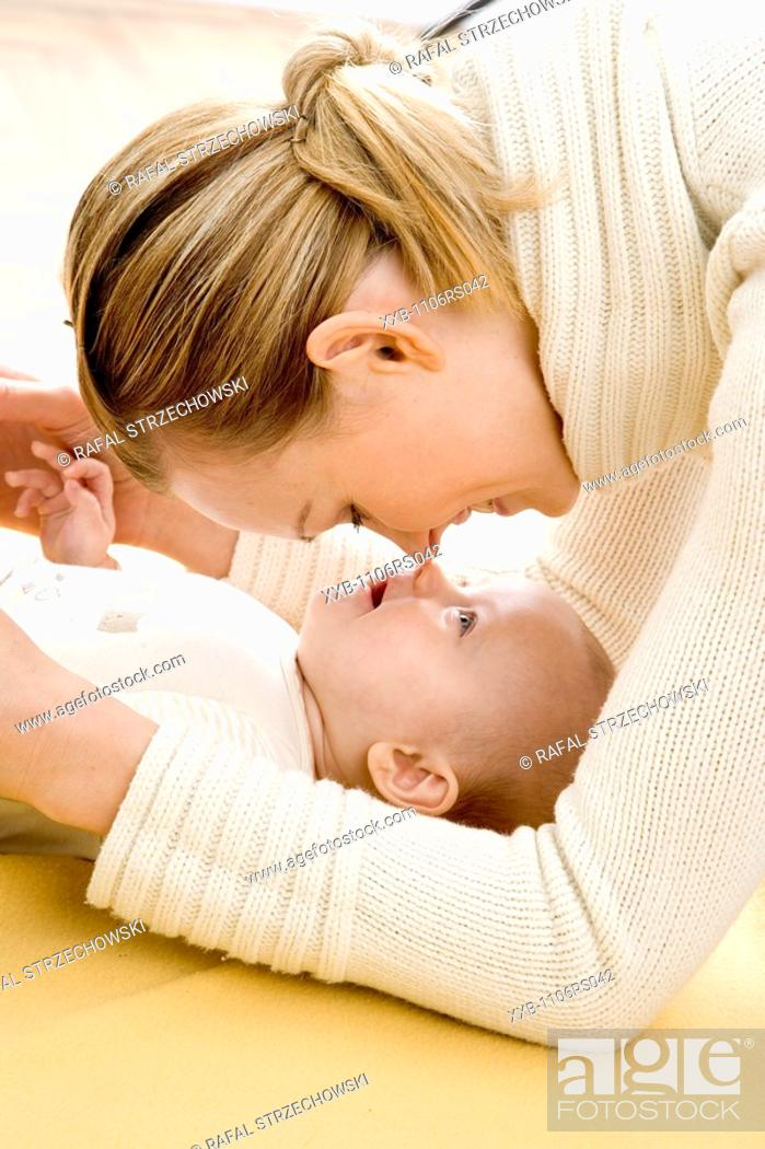 Stock Photo: happy mother with infant.