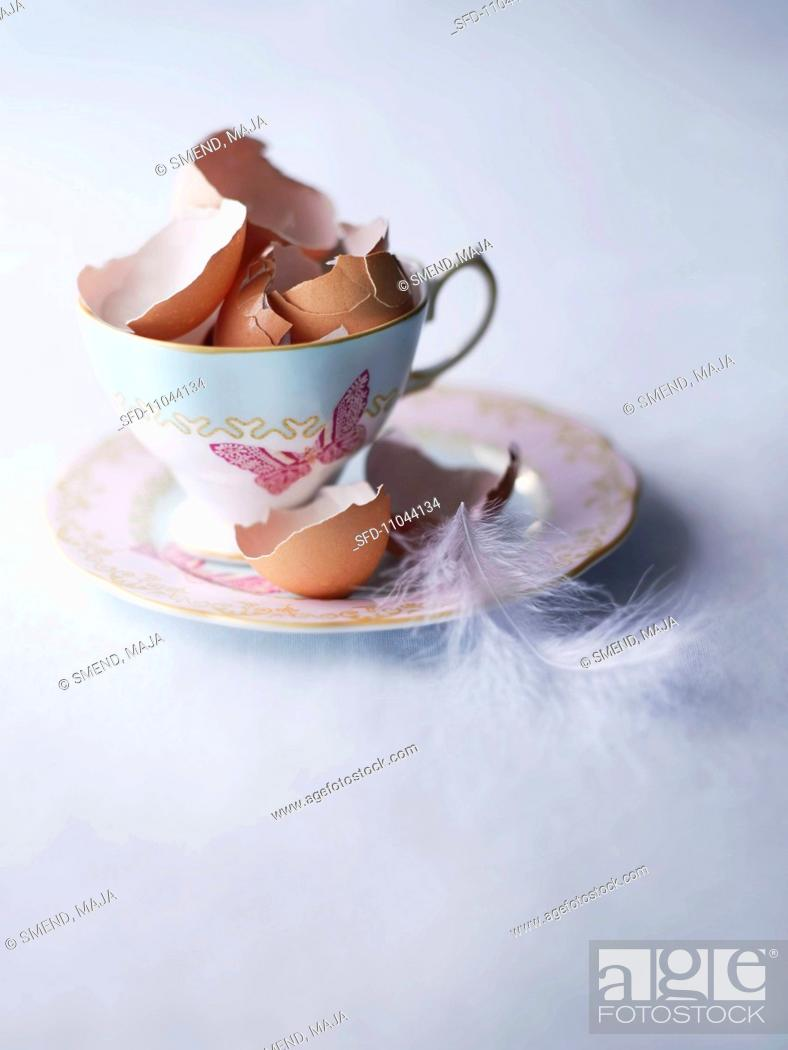 Stock Photo: Broken eggs shells in a porcelain cup.