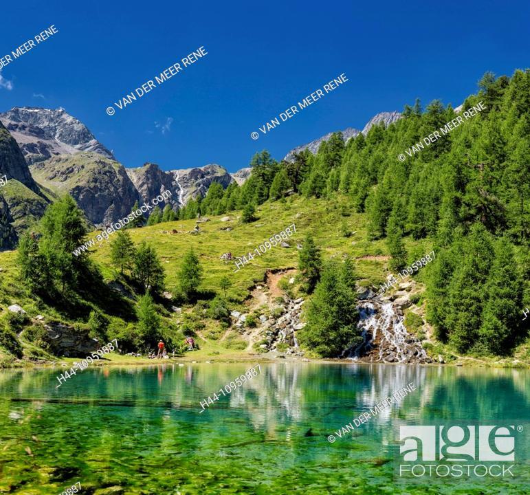 Imagen: Lac Bleu, lake, landscape, water, summer, mountains, hills, people, La Gouille, Val d'Herens, Wallis, Valais, Switzerland, Europe,.