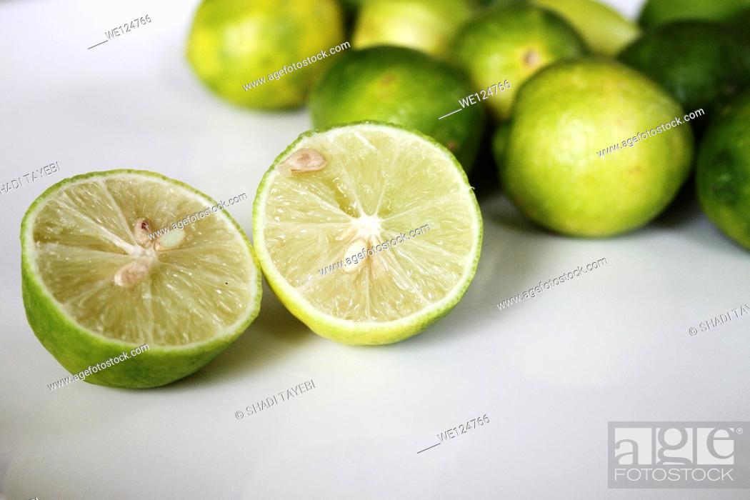 Stock Photo: Fresh limes on white background.