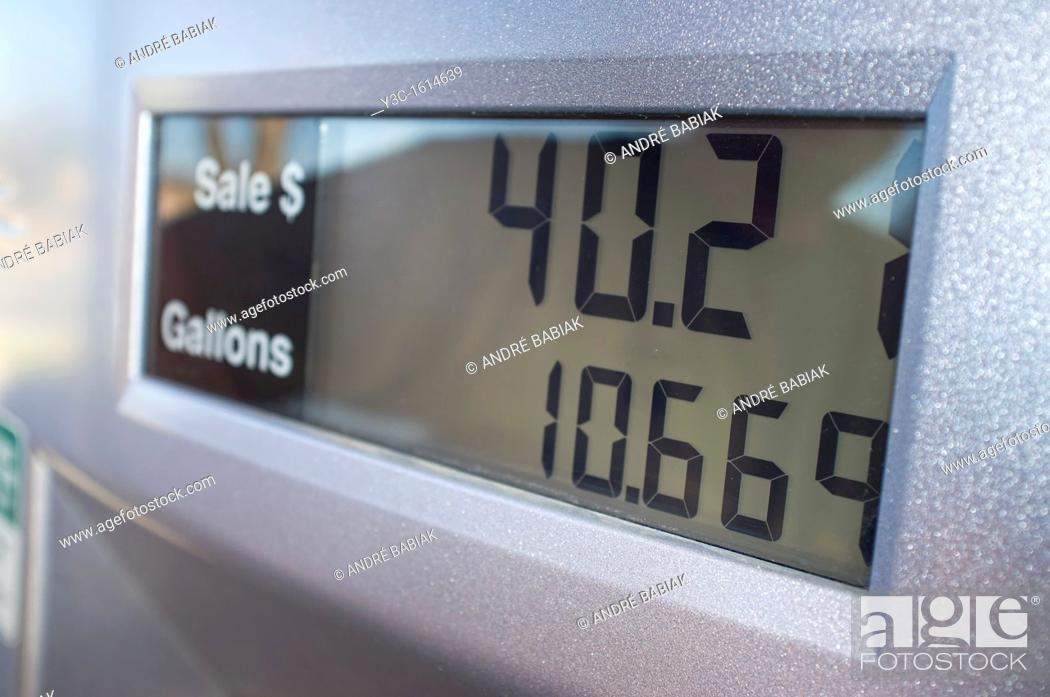Stock Photo: Display of fuel pump showing gallons and price at gas station.
