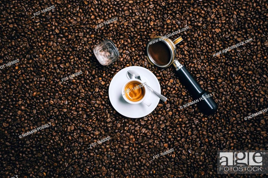 Stock Photo: Directly above shot of espresso cup with filter on roasted coffee beans.