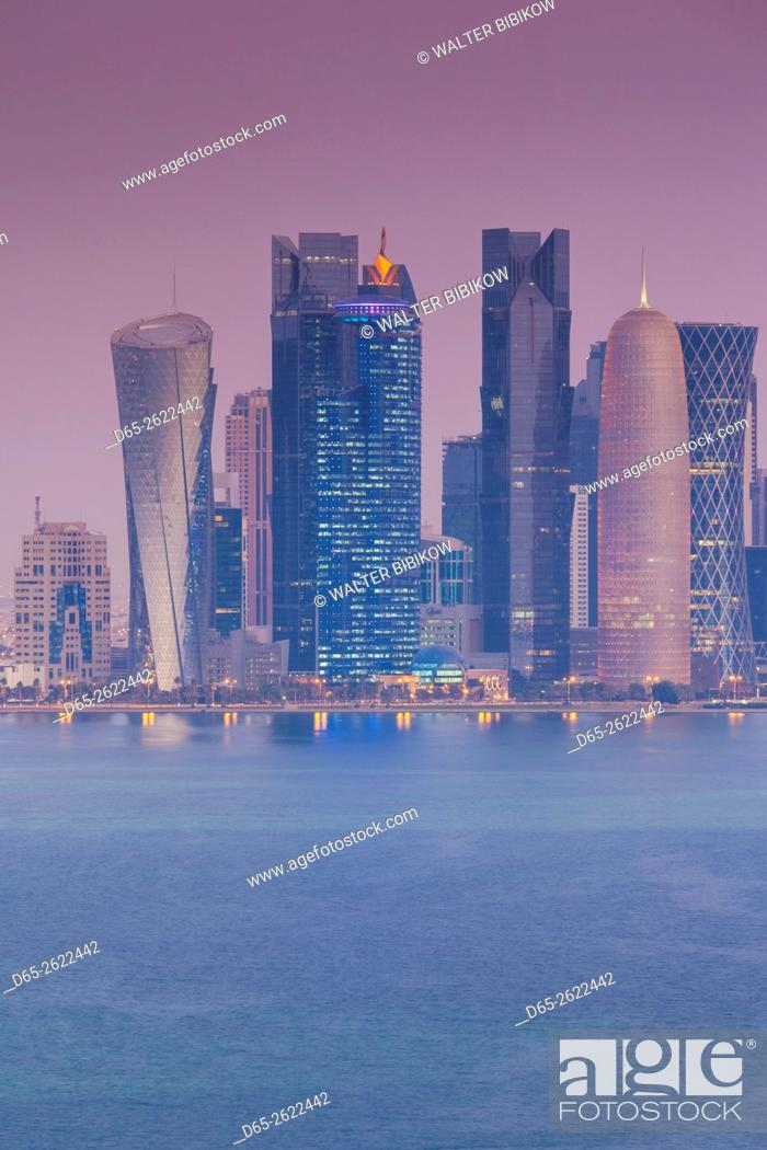 Stock Photo: Qatar, Doha, Doha Bay, West Bay skyscrapers, elevated view, dawn.