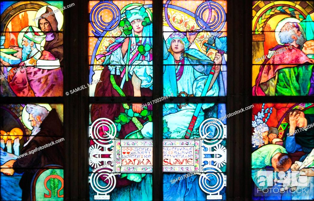 Stock Photo: Stained Glass Window, depicting a scene of an allegory of Christ blessing the Slavic nations. Seen is the lower part of the window.