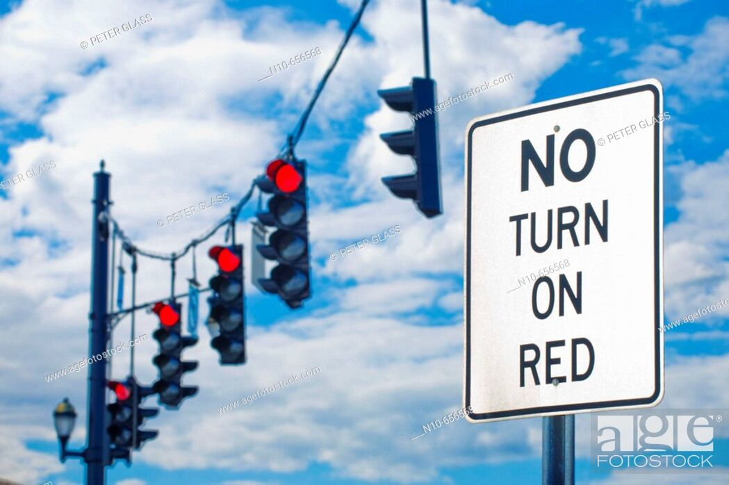 Stock Photo: 'No Turn On Red' sign and traffic signal lights on red.