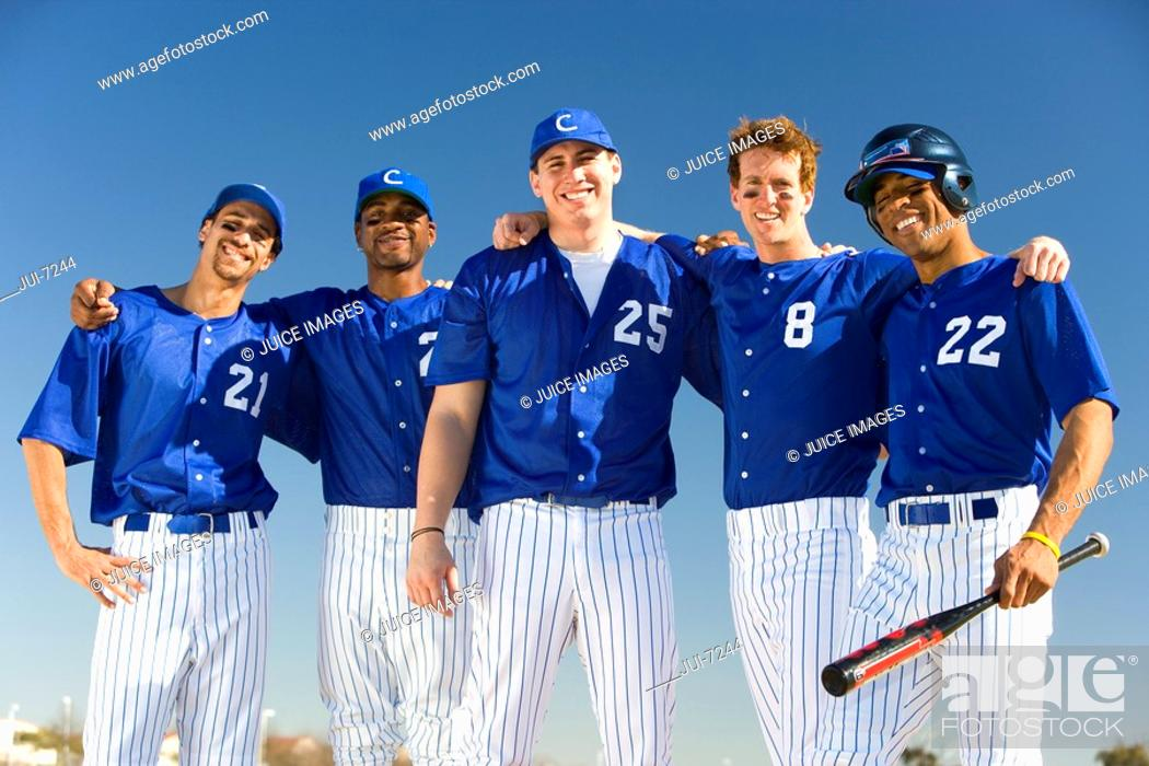 Stock Photo: Baseball team, in blue uniforms, standing side by side, arms around each other, smiling, front view, portrait.